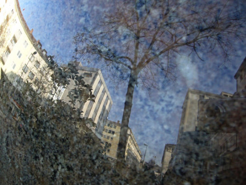 buildings reflected on stone