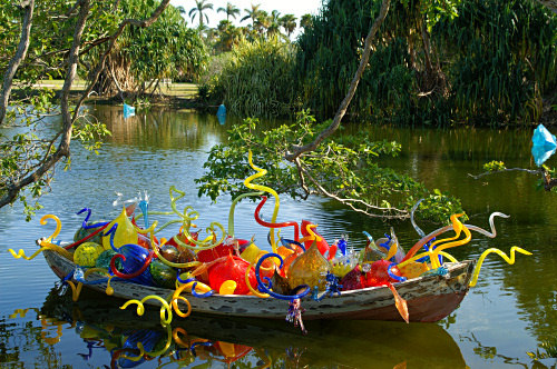 A boat filled with glass plants