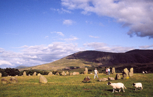 sheep, tourists and a stone circle in Castelrigg (Cumbria, England)