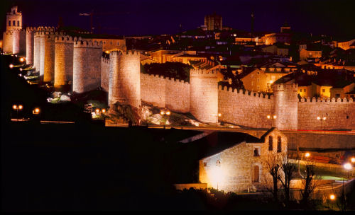 Medieval walls of �vila at night