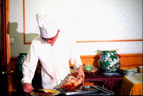 Preparing a Beijing Duck.