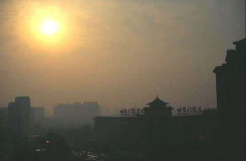 Smog. Sunrise in Beijing.