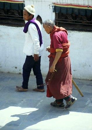 Monk walking around the Stupa. border=