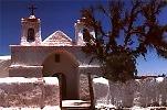 Chile I:  Andes: Salar de Surire;  vizcacha (a relative of the Chinchilla); evening Sun in the Andes; typical village;  Typical Vegetation of the Altiplano: llareta.  Grazing Guanacos;  Llamas;  Church of Isluga; Toconao; Quebrada de Jeria;  Chile or the moon? Valle de la luna. Cemetery near Arica.